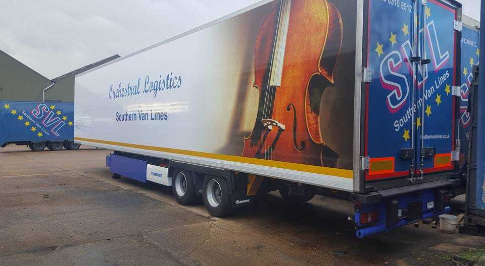 Temperature controlled trailer for transporting orchestra musical instruments.